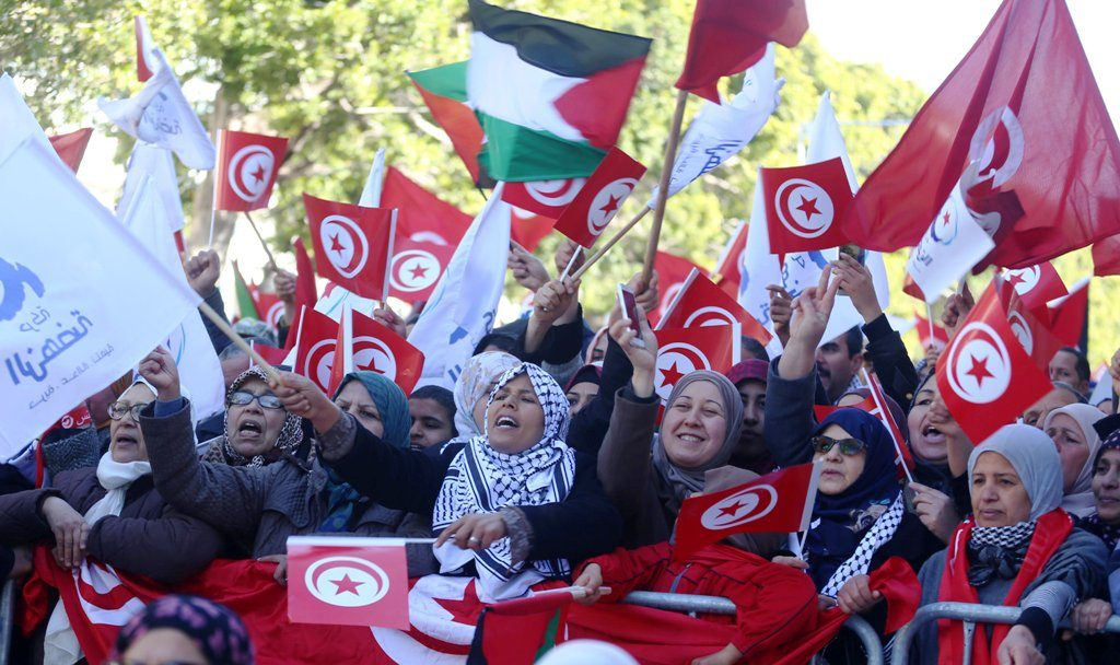 People wave national flags during demonstrations on the seventh anniversary of the toppling of president Zine El-Abidine Ben Ali, in Tunis, Tunisia January 14, 2018. REUTERS/Zoubeir Souissi
